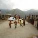 children dancing in remote village