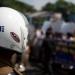 watchful eye - police at sri lanka rally